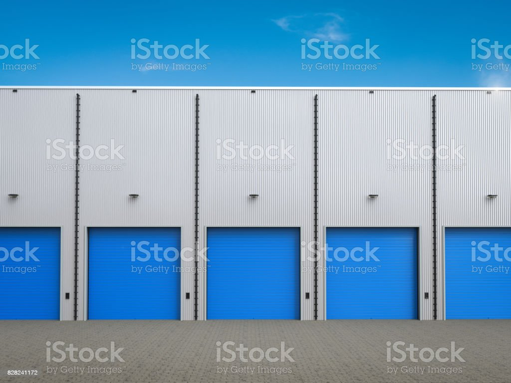 warehouse exterior with shutter doors stock photo