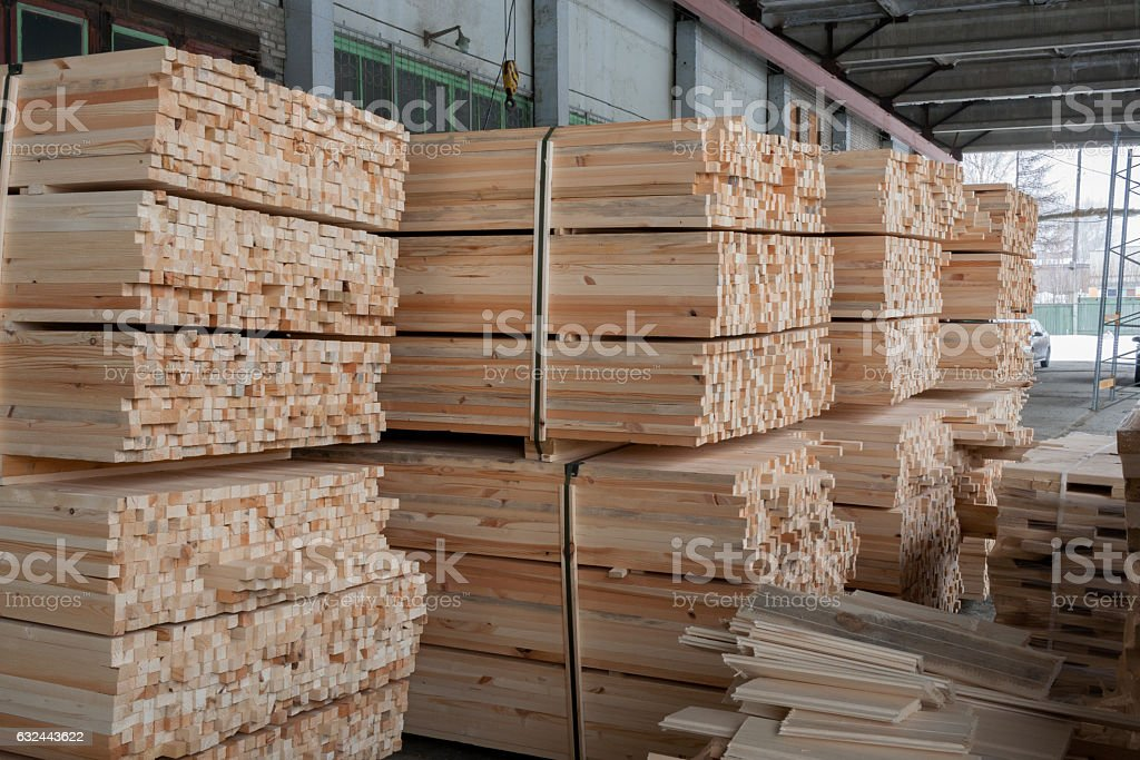Warehouse: fastened sawn rectangular wooden pine sticks. stock photo