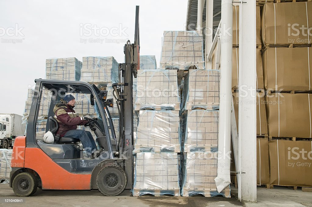 warehouse forklift loader at work royalty-free stock photo