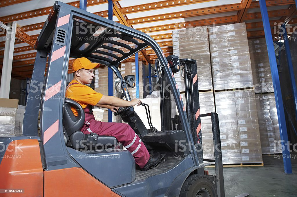 warehouse forklift loader worker royalty-free stock photo
