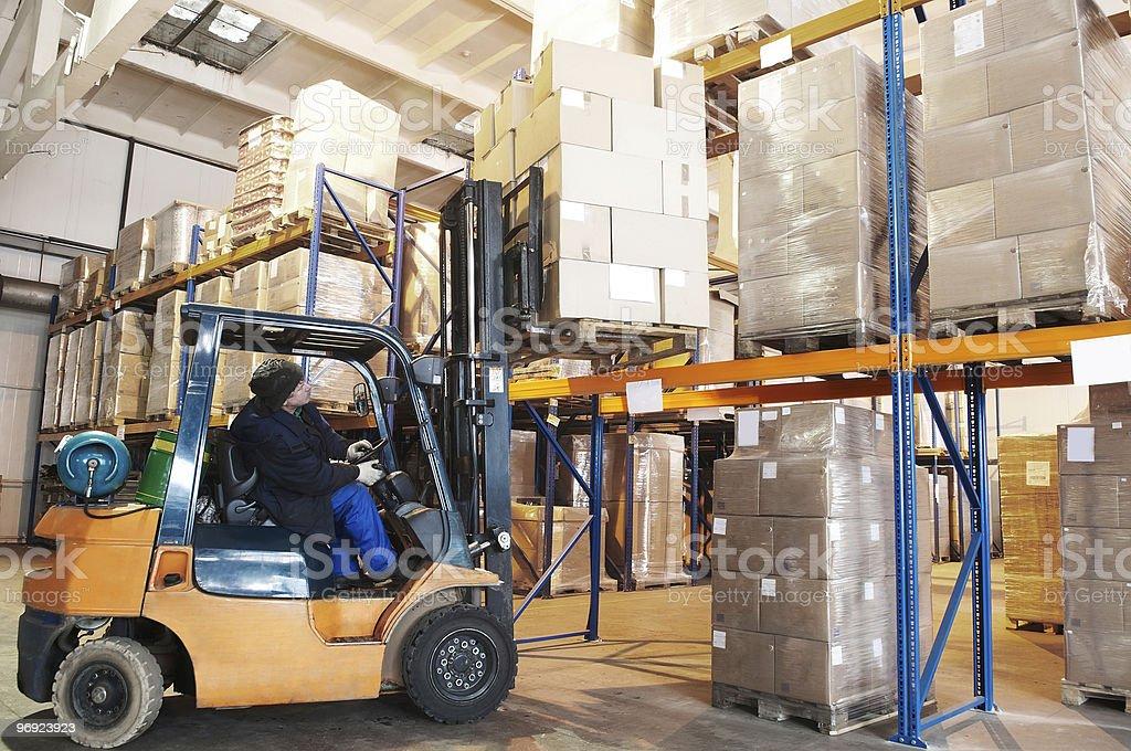 warehouse forklift loader worker stock photo