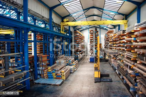 Yellow fork lifter working in big warehouse