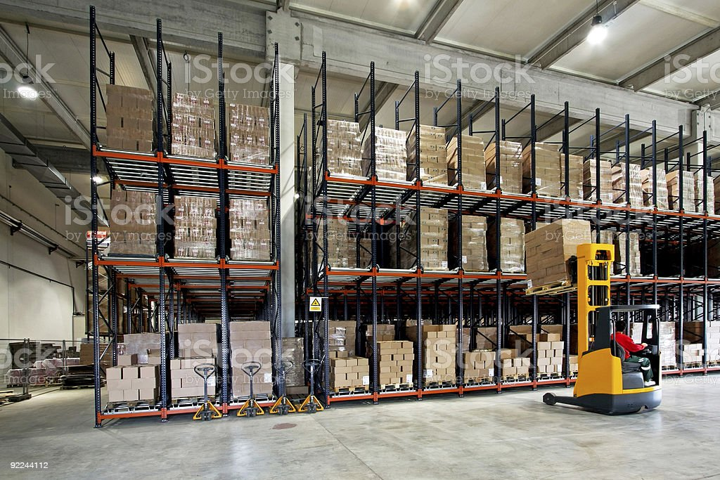 Warehouse forklifter stock photo