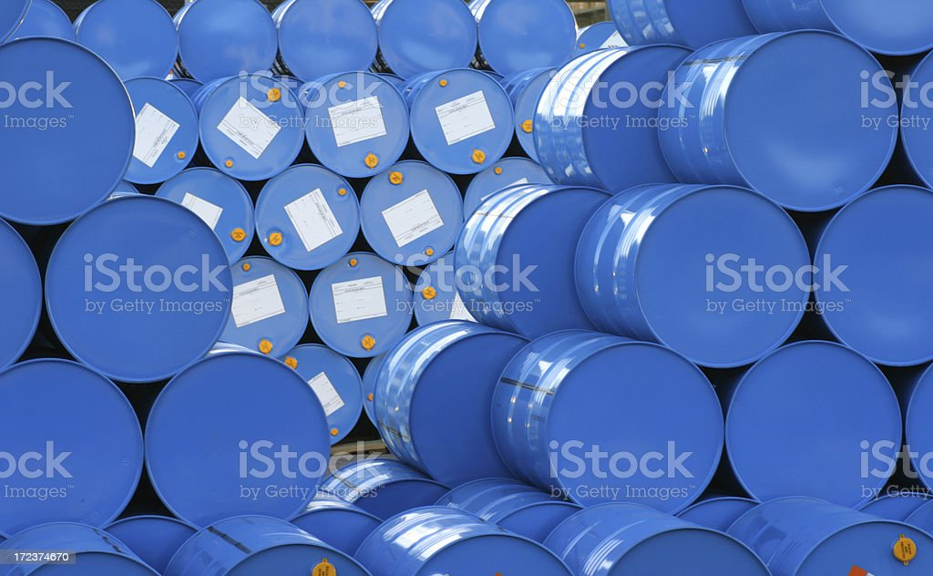 A warehouse full of blue Hugh barrels  stock photo