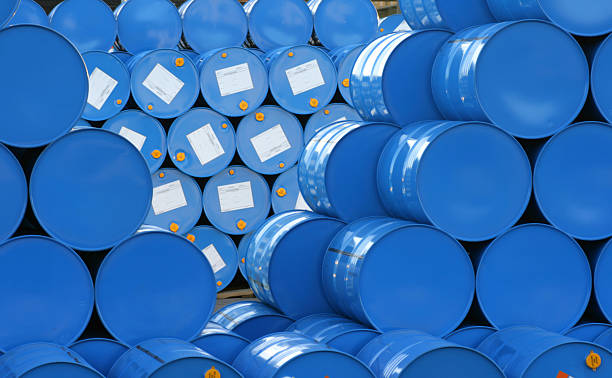 a warehouse full of blue hugh barrels  - chemical stock photos and pictures