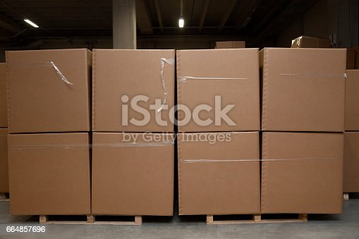 istock Warehouse full of commercial goods and cardboard boxes 664857696
