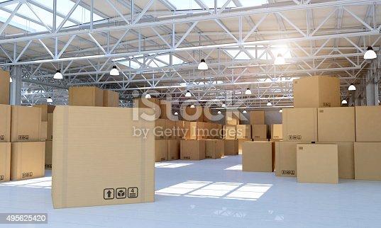 istock Warehouse full of goods: focus on one customizable cardboard box 495625420