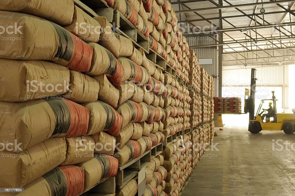 Warehouse full of sacks stacked from floor to ceiling royalty-free stock photo