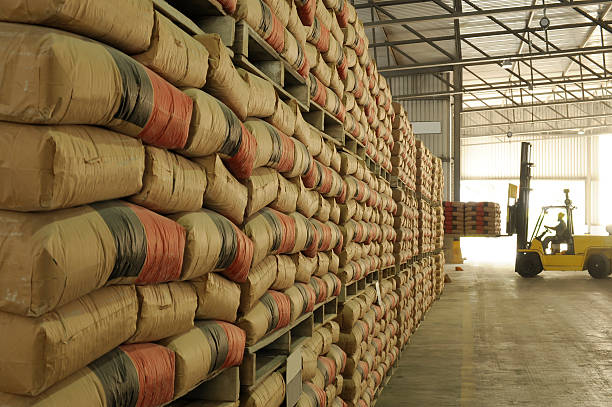 Warehouse full of sacks stacked from floor to ceiling stock photo