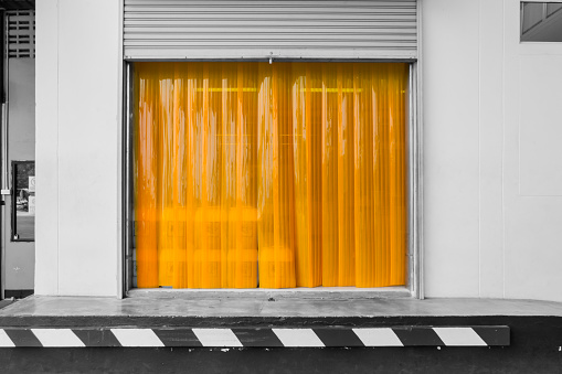 Warehouse gate loading area with PVC strip curtain or plastic strip doors.