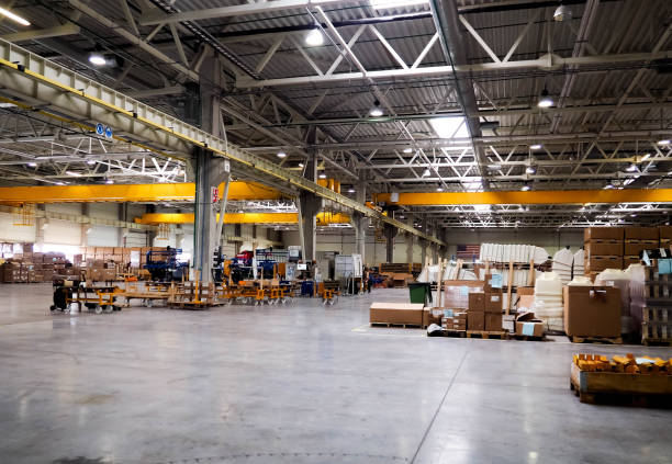 warehouse industrial premises for storing materials and wood, there is a forklift for containers. concept logistics, transport. motion blur effect. bright sunlight. - warehouse stock photos and pictures