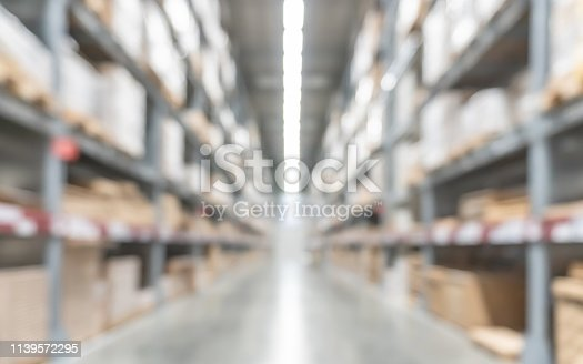 istock Warehouse industry blur background with  logistic wholesale storehouse, blurry industrial silo interior aisle for furniture merchandise inventory and wood material, construction supplies big box store 1139572295