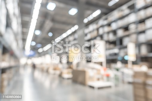 istock Warehouse industry blur background with  logistic wholesale storehouse, blurry industrial silo interior aisle for furniture merchandise inventory and wood material, construction supplies big box store 1163850564