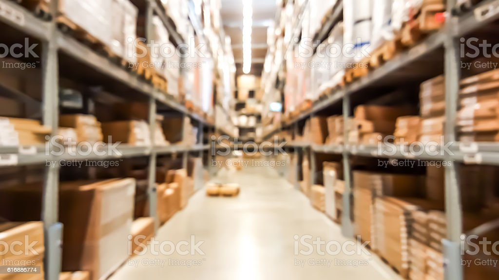 Warehouse inventory in defocus blur background style. stock photo
