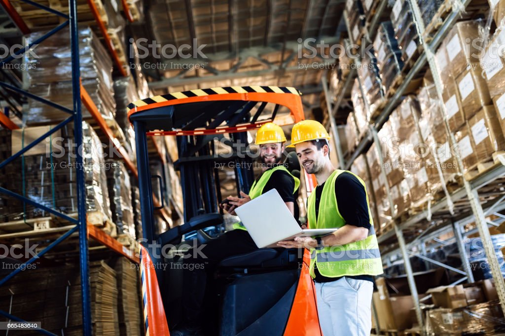 Warehouse logitics work being done with forklift stock photo