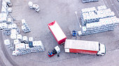Warehouse man worker with forklift. Loading truck. Aerial