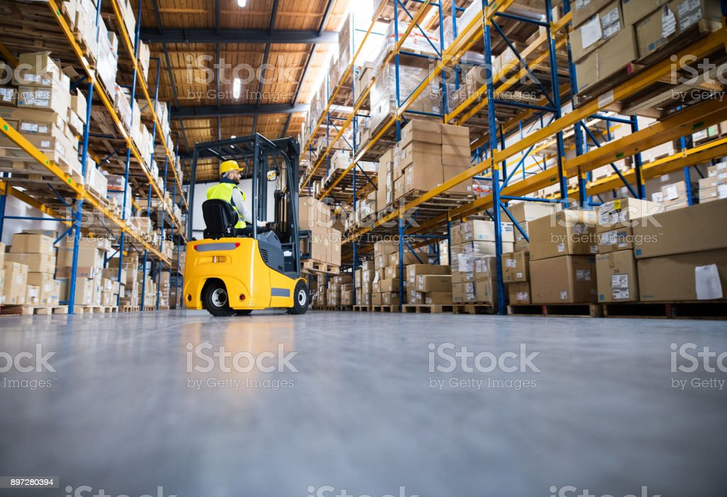Warehouse man worker with forklift. royalty-free stock photo