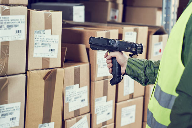 Warehouse Management System. Worker with barcode scanner stock photo