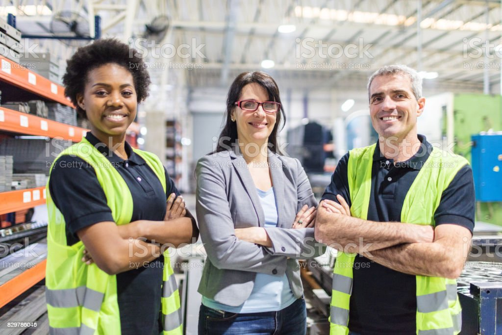 Warehouse manager and workers standing together royalty-free stock photo
