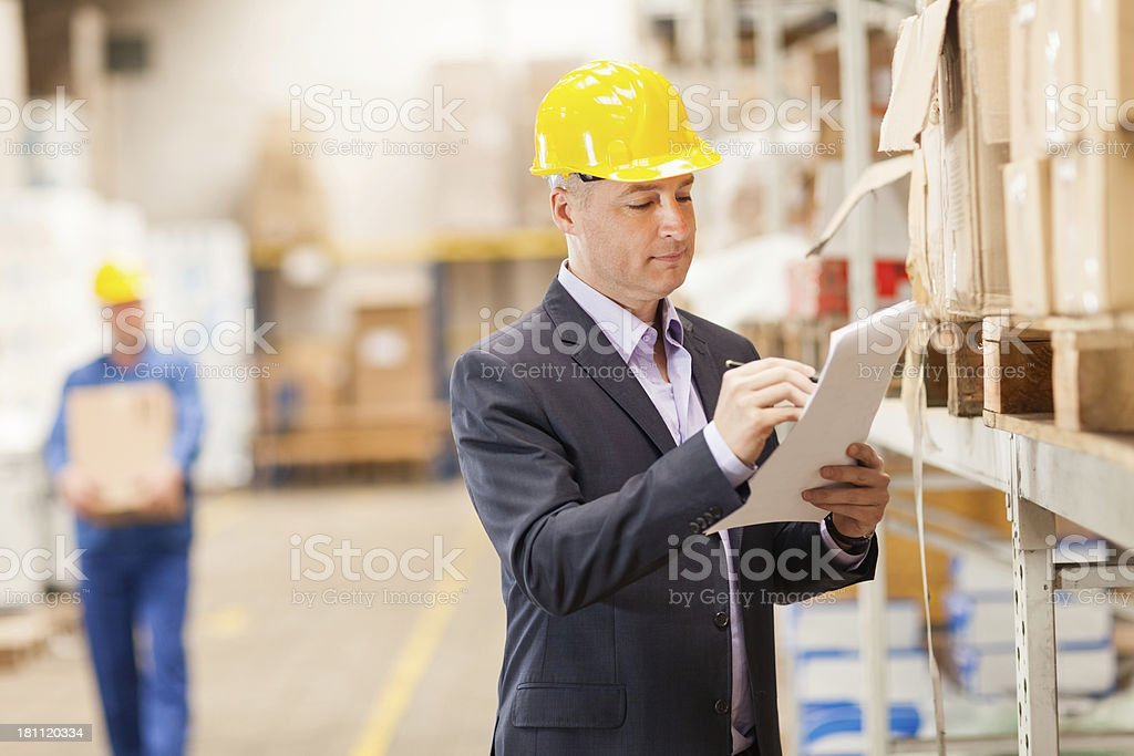 Warehouse manager checking inventory royalty-free stock photo