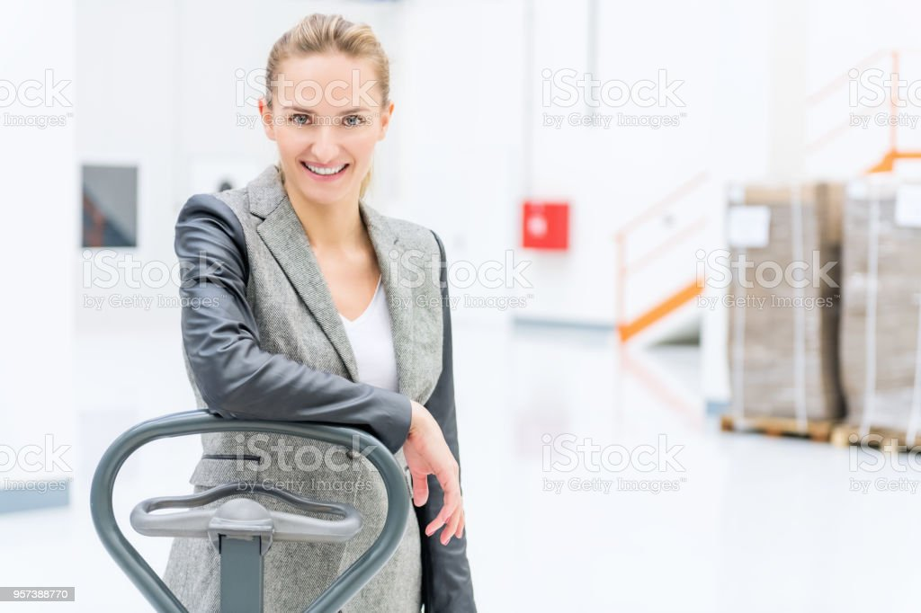Warehouse manager & pallet truck stock photo