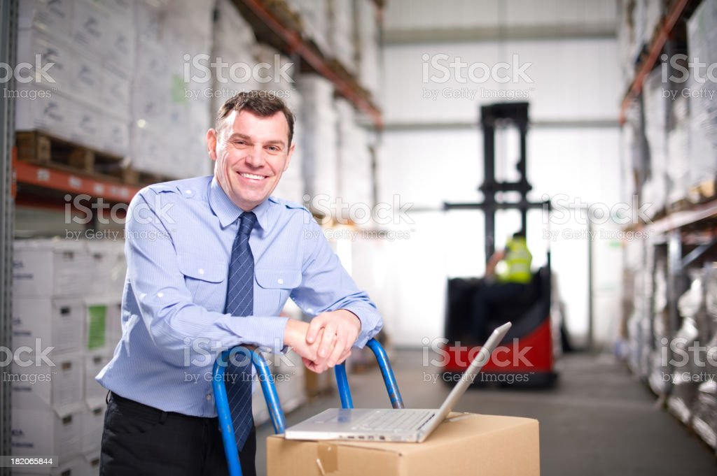 Warehouse Manager with a Laptop royalty-free stock photo