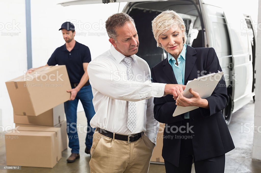 Warehouse managers checking their list stock photo
