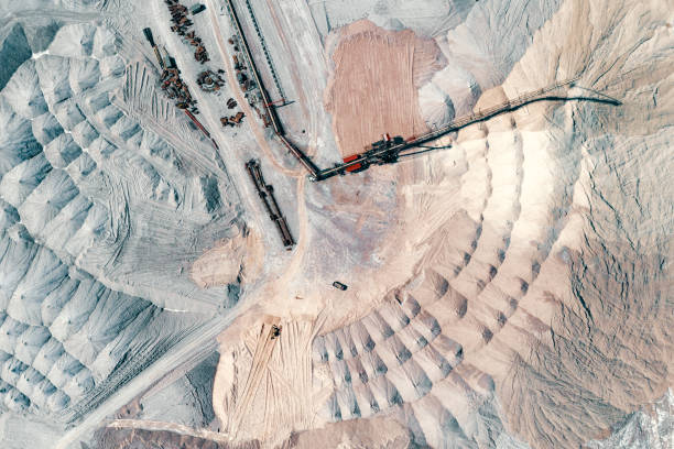 Warehouse of unused rock. Ore is stored in huge mounds. A system of long belt conveyors and spreaders. stock photo