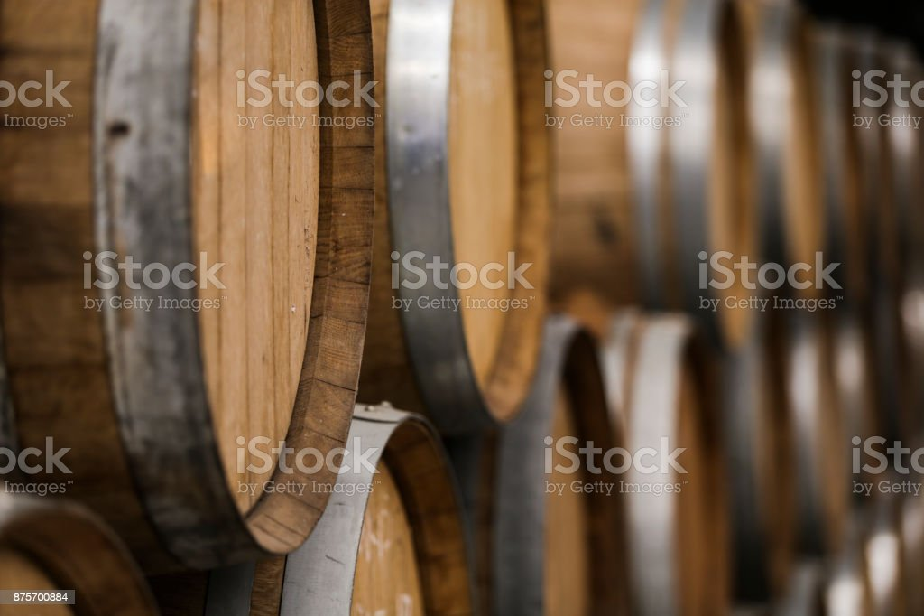 warehouse of wooden barrels with beer and wine stock photo