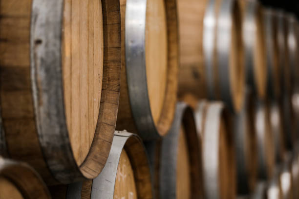 warehouse of wooden barrels with beer and wine - barrica imagens e fotografias de stock
