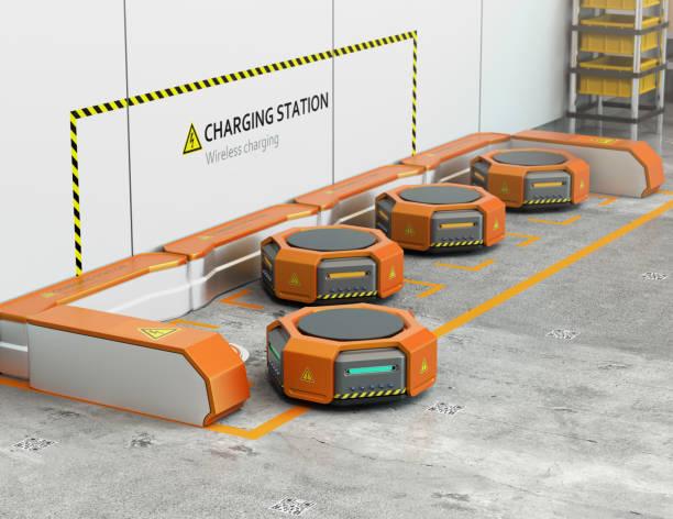 warehouse robotar laddning på laddstationen - delivery robot bildbanksfoton och bilder