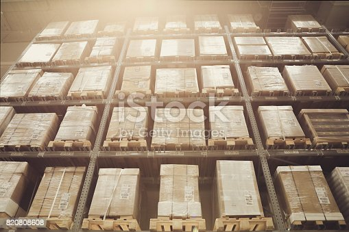 istock Warehouse shelves with goods 820808608