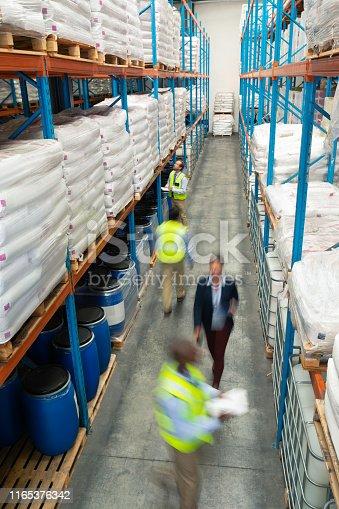 1165376915istockphoto Warehouse staff checking stocks in warehouse 1165376342