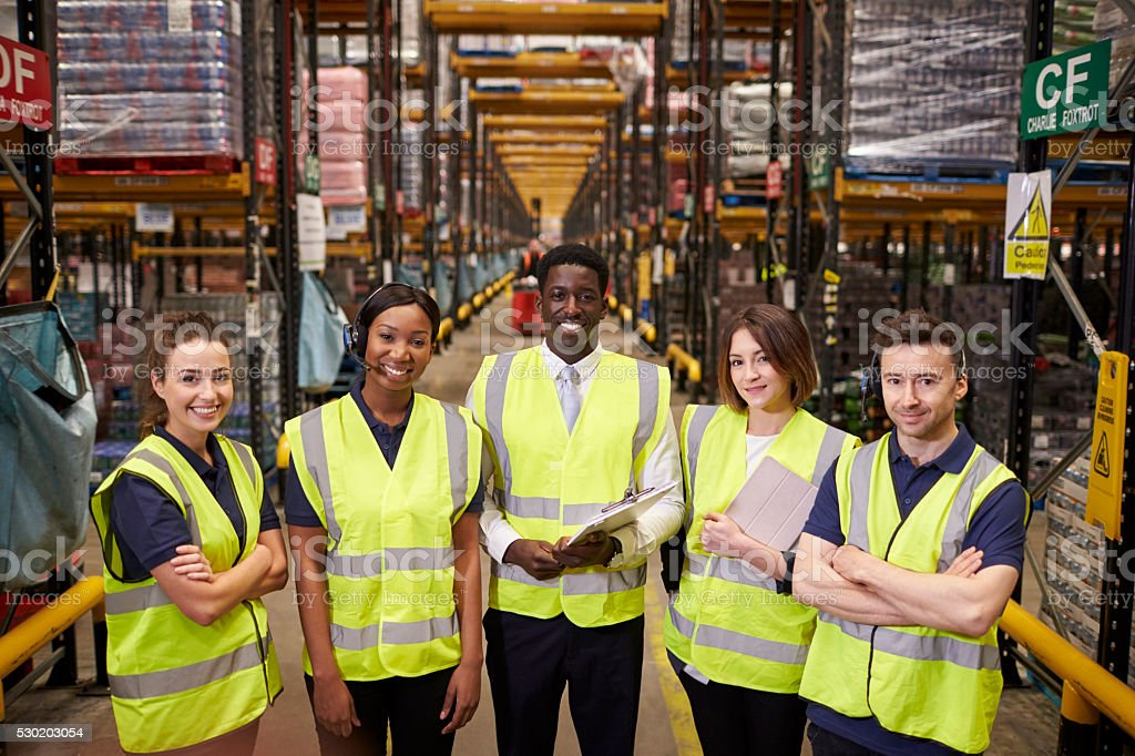 Warehouse staff group portrait, elevated view stock photo