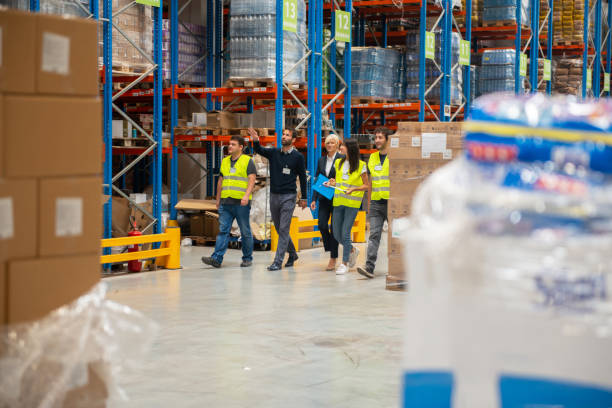 Warehouse staff meeting, workers with mnagers stock photo