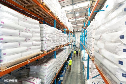 istock Warehouse staff working together in warehouse 1165376848