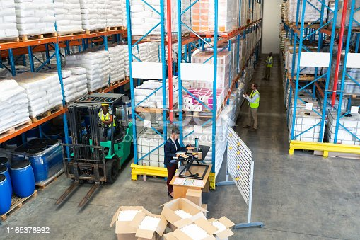 istock Warehouse staff working together in warehouse 1165376992