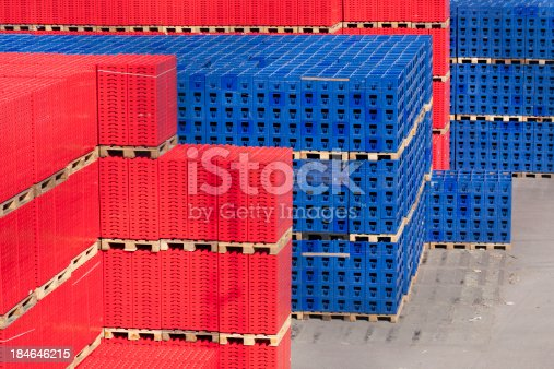 Huge piles of crates for distribution of bottles.