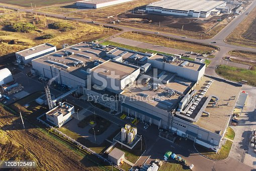 Warehouse storage or industrial factory or logistics center from above, aerial view.