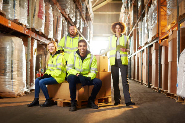 warehouse team a warehouse team pose for a group shot pallet jack stock pictures, royalty-free photos & images
