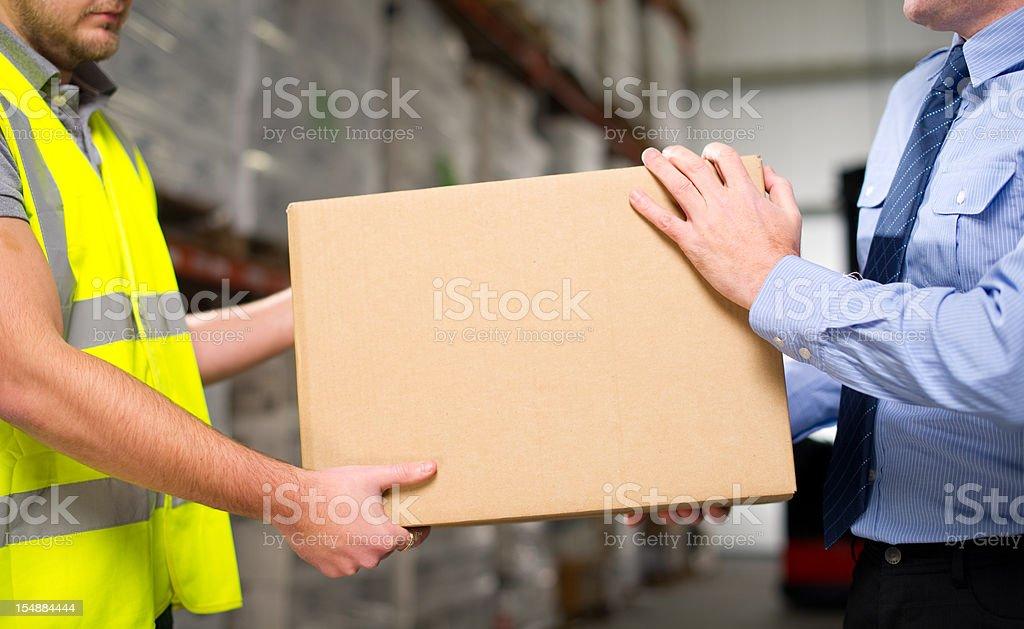 Warehouse Teamwork royalty-free stock photo