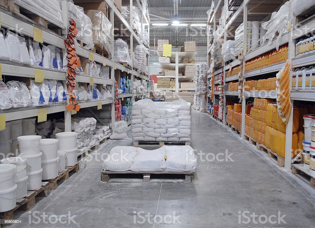 Warehouse with shelves full of building materials stock photo