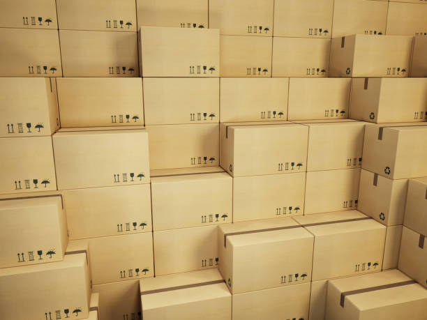 warehouse with stack of cardboard boxes stock photo