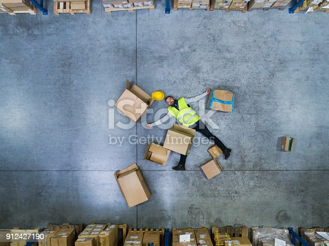 istock Warehouse worker after an accident in a warehouse. 912427190