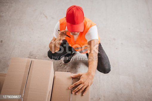 warehouse worker checking dates
