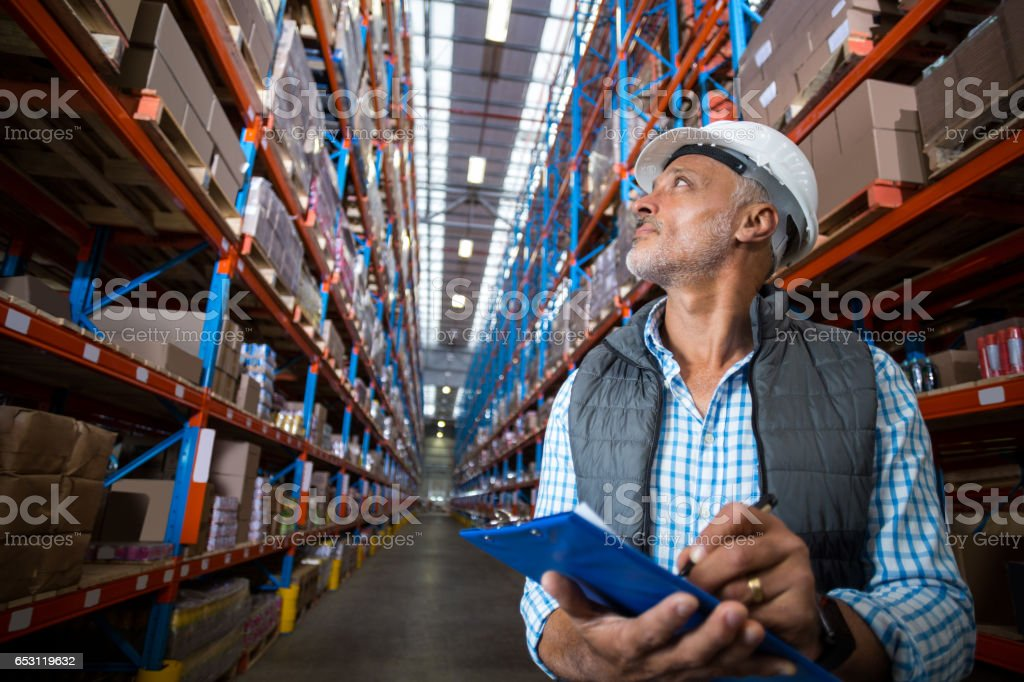 Warehouse worker checking the inventory stock photo