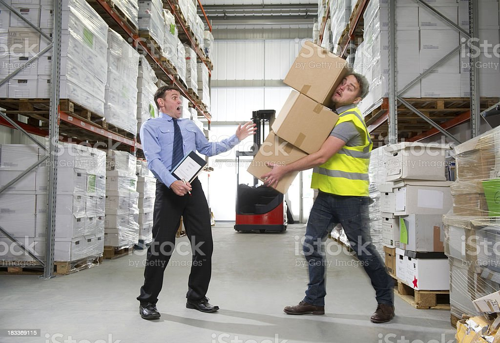 Warehouse Worker Dropping A Stack Of Boxes Stock Photo