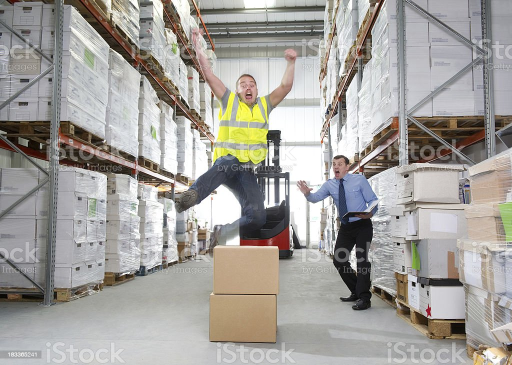 Warehouse Worker Hurdling Boxes royalty-free stock photo