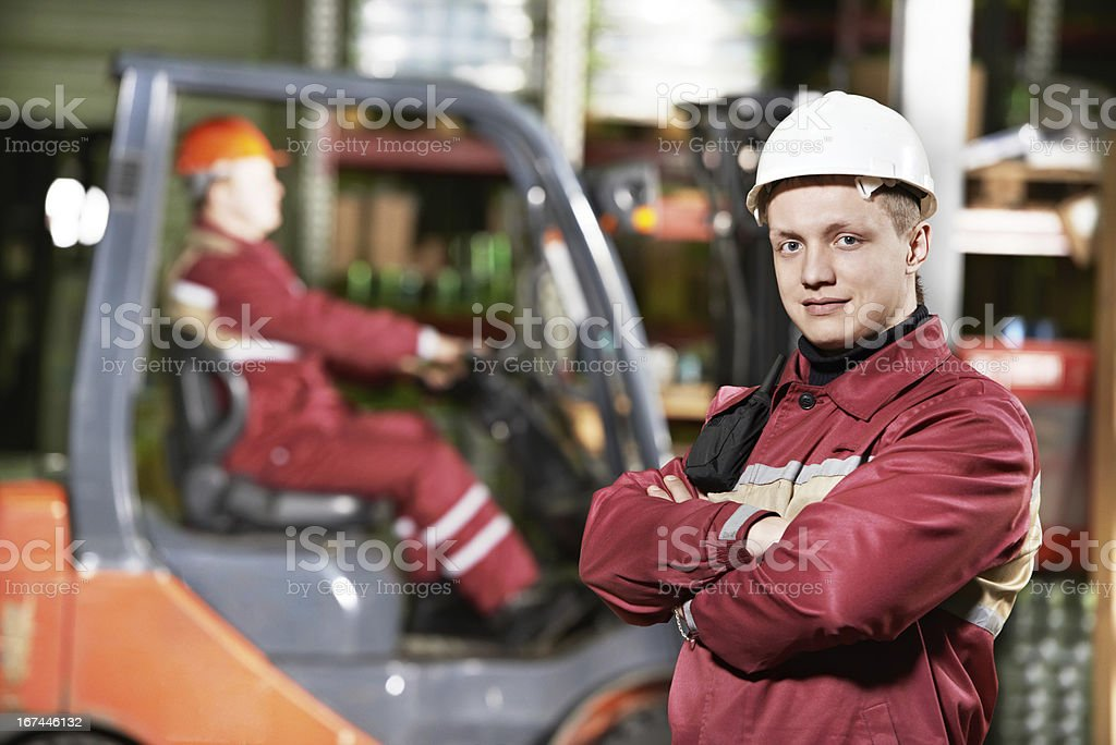 warehouse worker in front of forklift royalty-free stock photo