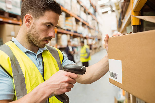Warehouse worker pictures images and stock photos istock warehouse worker scanning barcodes on boxes stock photo sciox Choice Image